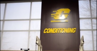 Inside the Indoor Athletic Complex are multiple flying C's and displayed are the words Conditioning to title the atmosphere.