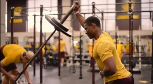 Junior baseball pitcher, Dazon Cole, does his shoulder lifts during his daily weight lifting practice.